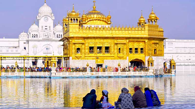 People sitting out the Golden Template, India (Amritsar)
